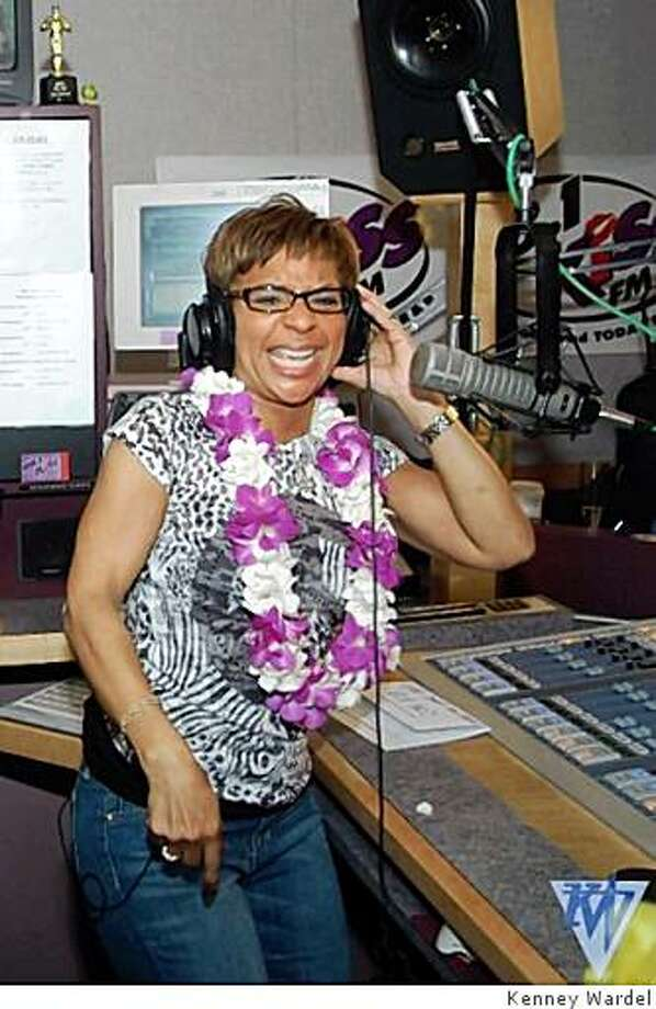 Renel Brooks-Moon gets her groove on and dances to one of her favorite jams during her last show on KISS-FM. Photo: Kenney Wardel