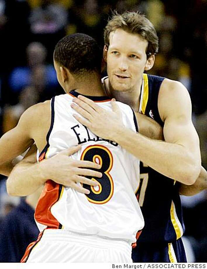 Indiana Pacers' Mike Dunleavy embraces his former teammate, Golden State Warriors' Monta Ellis prior to their basketball game Sunday, Jan. 13, 2008, in Oakland, Calif. (AP Photo/Ben Margot) Photo: Ben Margot, ASSOCIATED PRESS