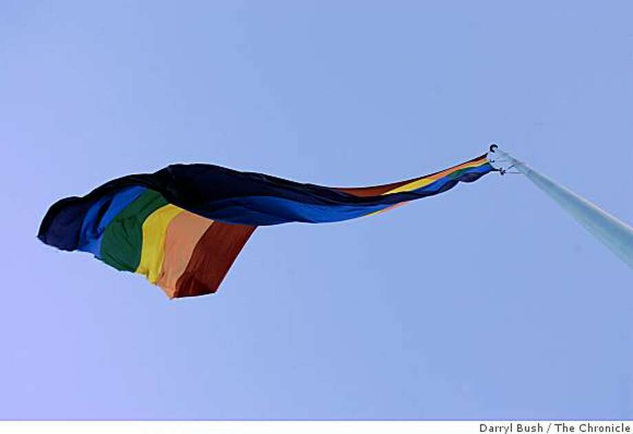A large rainbow flag flies in the Castro District to signify gay pride. Photo: Darryl Bush, The Chronicle