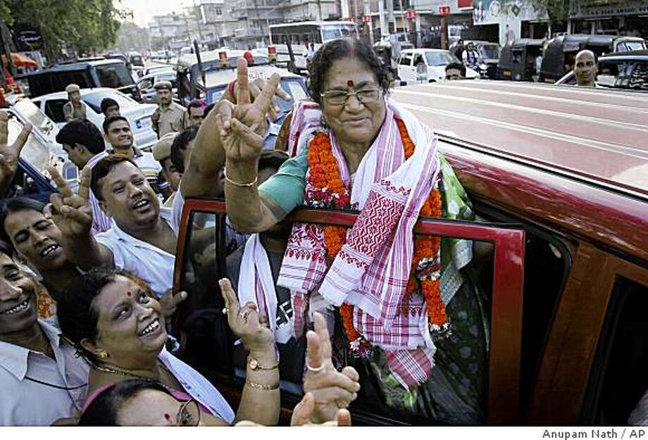 India's main opposition Bharatiya Janata Party leader Bijoya Chakraborty, right, shows victory sign after winning, in Gauhati, India, Saturday, May 16, 2009. The Congress party headed to a resounding victory Saturday in India's monthlong national elections, defying expectations of a poor showing to secure a second term in power as the country battles an economic downturn. (AP Photo/Anupam Nath) Photo: Anupam Nath, AP
