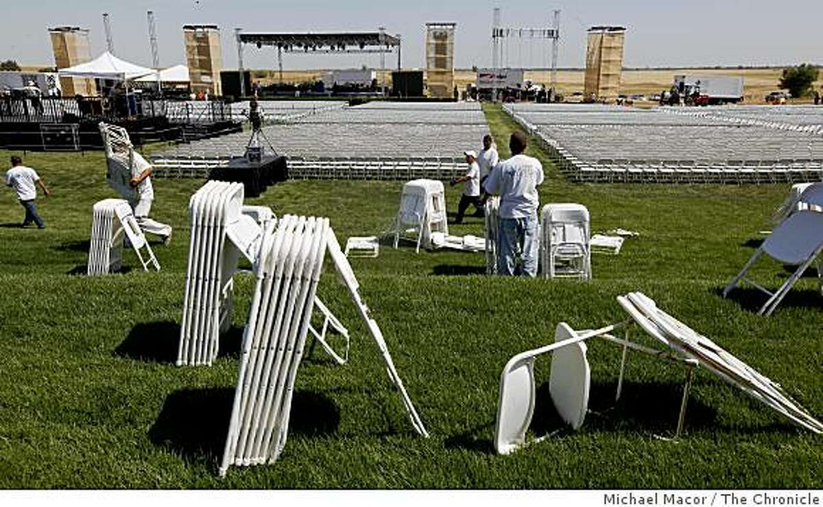 Workers on Thursday, May 14, 2009, install seating for the expected 12,000, who will will come to UC Merced to hear First Lady Michelle Obama deliver the commencement speech this Saturday for the first full graduating class.