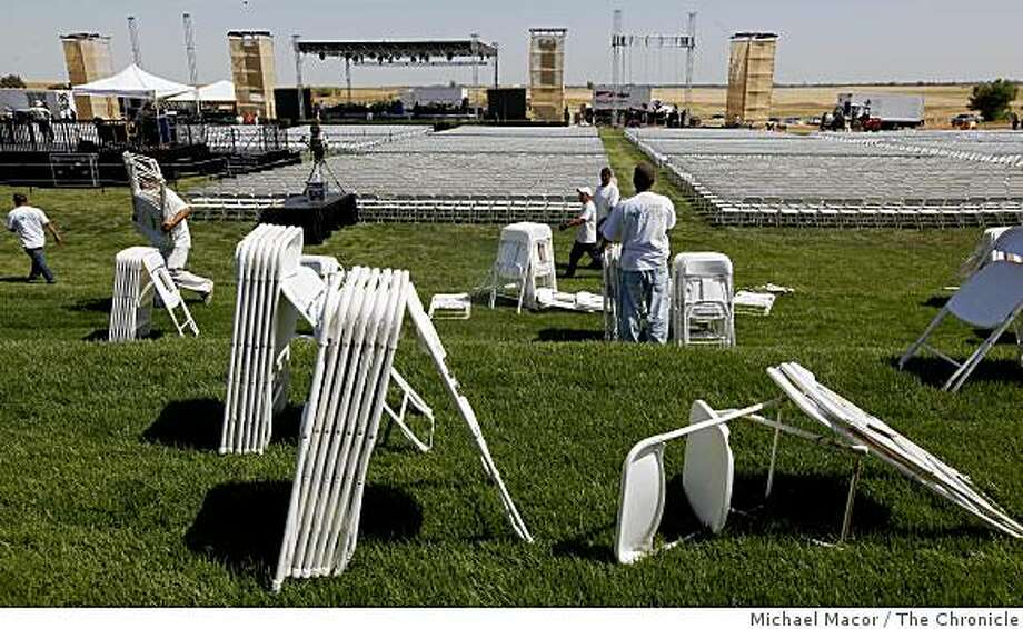 Workers on Thursday, May 14, 2009, install seating for the expected 12,000, who will will come to UC Merced to hear  First Lady Michelle Obama deliver the commencement speech this Saturday for the first full graduating class. Photo: Michael Macor, The Chronicle