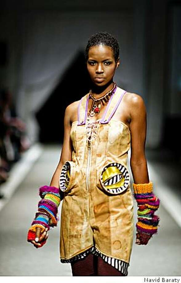 A rusted canvas jumpsuit, shorts and fingerless gloves by Heather Johnson was part of the California College of Arts fashion graduate show May 8, 2009. Photo: Navid Baraty