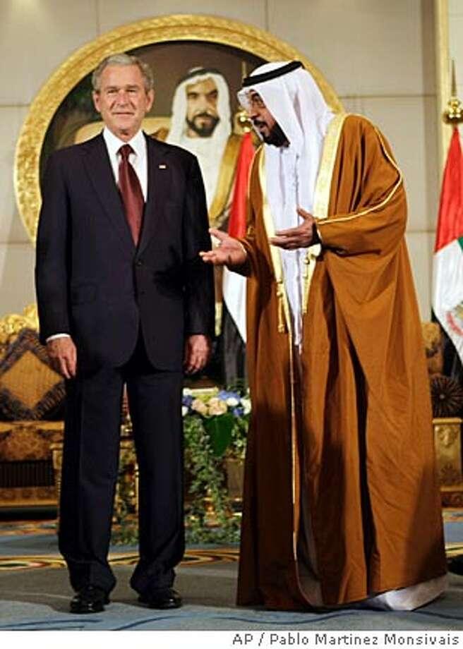 U.S. President George W. Bush, left, with United Arab Emirates President Sheik Khalifa bin Zayed Al Nahyan, right, during the arrival ceremony at Al Mushref Palace, Sunday, Jan. 13, 2008 in Abu Dhabi, United Arab Emirates. (AP Photo/Pablo Martinez Monsivais) Photo: Pablo Martinez Monsivais