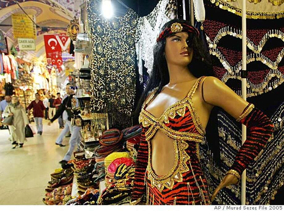 **FOR IMMEDIATE RELEASE** FILE** Visitors walk pass a shop which sells traditional Turkish bellydance costumes at the Ottoman era Grand Bazaar in Istanbul, Turkey, in this Sept. 27, 2005 file photo. (AP Photo/Murad Sezer)  Ran on: 01-13-2008 Ran on: 01-13-2008  Istanbul's Grand Bazaar, the world's oldest shopping mall, is the place to come for all your belly-dancing supply needs. Photo: MURAD SEZER