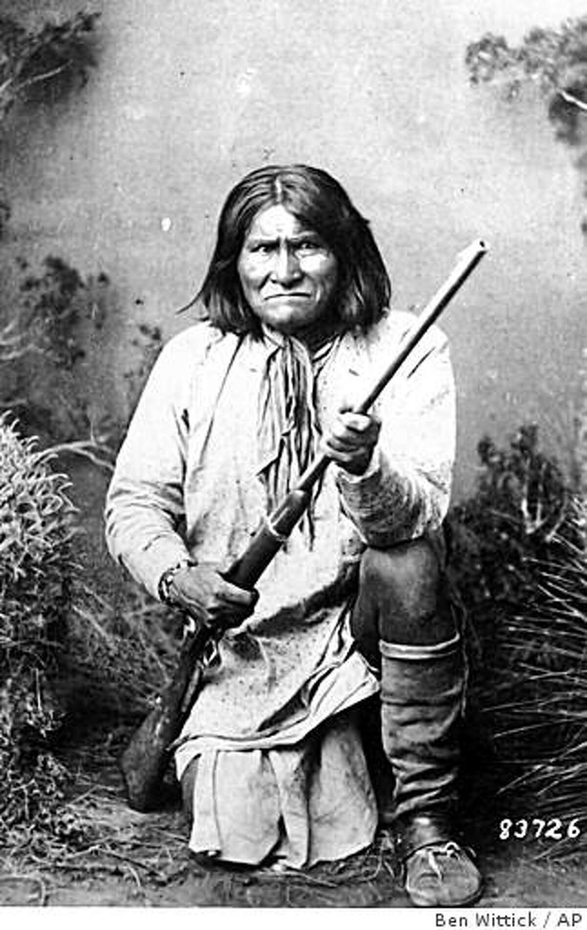 ** ADVANCE FOR SUNDAY, MAY 17 **This photo, provided by the National Archives, shows the famed Indian warrior Geronimo, a Chiricahua Apache, posing with a rifle in 1887. Historians say that many of the legends surrounding Geronimo are more myth than reality. (AP Photo/National Archives, Ben Wittick)