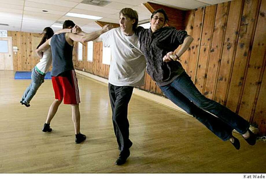 "Goldrush Dance Exhibition Team members, from left, Jennifer Foster, 20, Chris Dizmang, 20, Allen Crane, 20, and Amy Dizmang, 15, peform an ""Airplane Spin"" while rehearsing at the Cordelia Fire District  Hall, in Cordelia, Calif. on Sunday, May 3, 2009.  Photo by Kat Wade / Special to the Chronicle Photo: Kat Wade"