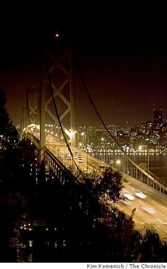 The ornamental lights on the Oakland San Francisco Bay Bridge and the lights in many governmental and commercial buildings in San Francisco, Calif are tuned off at 8:30 p.m. on Saturday, Mar. 28, 2009 in observance of Earth Hour. Photo: Kim Komenich, The Chronicle