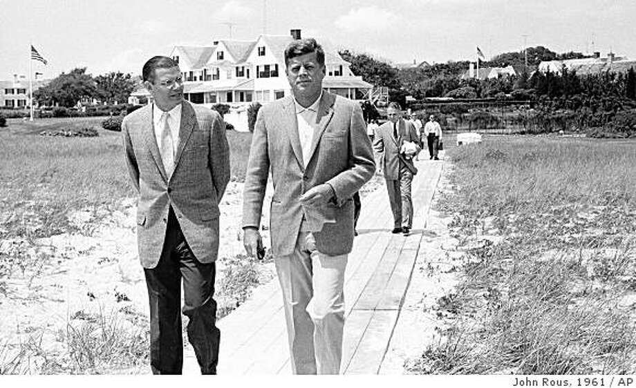 "**FOR USE SUNDAY, JAN. 6, AND THEREAFTER**FILE**President John Kennedy, right, walks with Secretary of Defense Robert McNamara towards a pier on Cape Cod to board the Kennedy family boat for an outing in this file photo taken July 8, 1961, at Hyannisport, Mass. The Cape's median age has risen about seven years, which can be partly blamed on the shorelines and landscapes that draw visitors from all corners and inspired famous residents such as the Kennedys. President Kennedy once said, ""I always go to Hyannisport to be revived, to know again the power of the sea, and the Master who rules over it, and all of us.""    (AP Photo/John Rous, file) Photo: John Rous, 1961, AP"