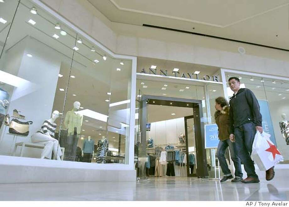 Shoppers walk by an Ann Talyor store at Westfield Valley Fair in Santa Clara, Calif., Thursday, Jan. 10, 2008. Many merchants who reported sales figures Thursday failed to meet already lowered sales projections, making this the weakest holiday season since 2002. Particularly hard hit were apparel sellers including Limited Brands Inc. and AnnTaylor Stores Corp., as well as department stores including Macy's Inc. (AP Photo/Tony Avelar) Photo: Tony Avelar