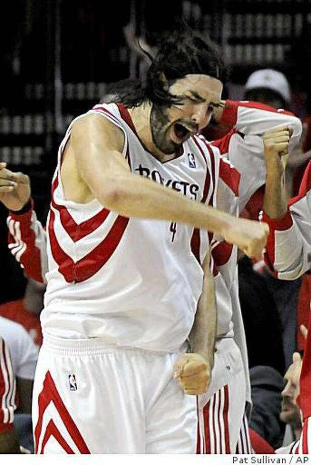 Houston Rockets' Luis Scola of Argentina reacts to scoring a basket against the Los Angeles Lakers during the second half of Game 6 of their NBA Western Conference playoffs basketball series Thursday, May 14, 2009 in Houston. The Rockets won 95-80 to tie the series at 3-3. (AP Photo/Pat Sullivan) Photo: Pat Sullivan, AP