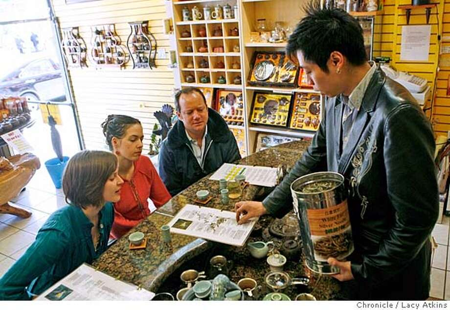 (left to right) Andrea Burke, Meghan Farley and Scott Beattie learn the different effects of teas from Haymen DeLuz at the Aroma Tea Shop, Monday January 7, 2008 in San Francisco, Ca. (Lacy Atkins San Francisco Chronicle) MANDATORY CREDIT FOR PHOTOG AND SAN FRANCISCO CHRONICLE/NO SALES-MAGS OUT Photo: Lacy Atkins