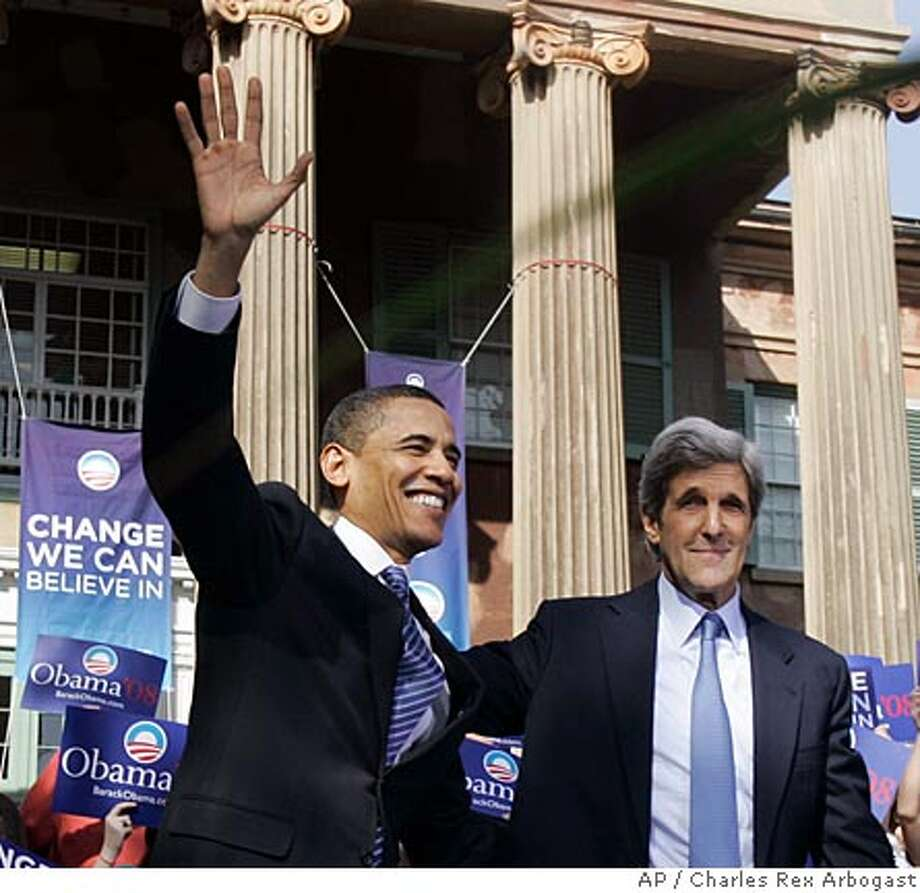 Democratic presidential hopeful Sen. Barack Obama, D-Ill. left, waves to the crowd after being introduced and endorsed by former Democratic presidential candidate U.S. Sen. John Kerry, D-Mass., during a rally on the College of Charleston campus in Charleston, S.C., Thursday, Jan. 10, 2008. (AP Photo/Charles Rex Arbogast) Photo: Charles Rex Arbogast