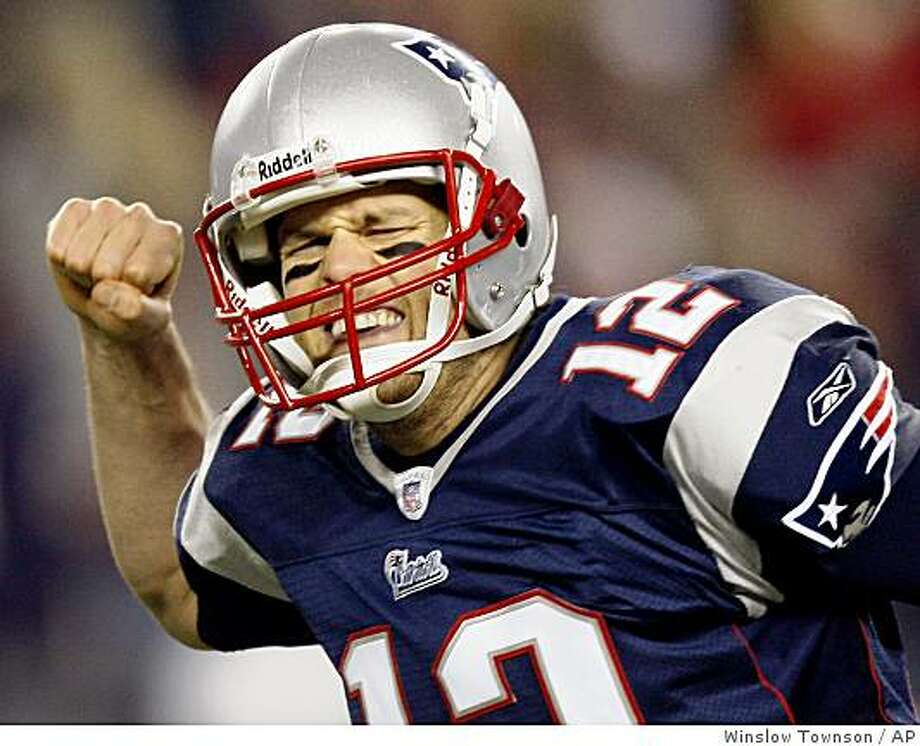New England Patriots quarterback Tom Brady celebrates after throwing a touchdown pass to tigh end Benjamin Watson during the second half of a NFL divisional playoff football game against the Jacksonville Jaguars, Saturday, Jan. 12, 2008 in Foxborough, Mass. (AP Photo/Winslow Townson) Photo: Winslow Townson, AP