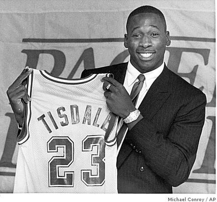 FILE- This Oct. 10, 1985 file photo shows Wayman Tisdale, holding up his the Indiana Pacer jersey after he signed his contract with the team in Indianapolis. Tisdale, a three-time All-American at Oklahoma who played 12 seasons in the NBA, has died after a two-year battle with cancer. He was 44. (AP Photo/Michael Conroy,File) Photo: Michael Conroy, AP