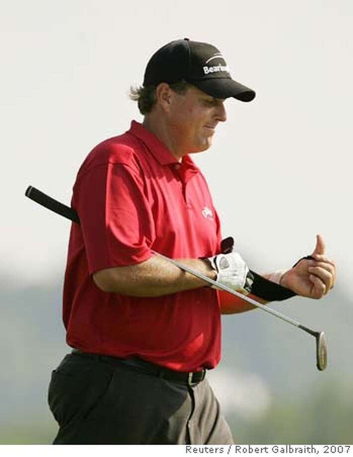 Phil Mickelson of the U.S. puts a strap on his wrist at the third hole during first round play at the 2007 US Open Championship golf tournament in Oakmont, Pennsylvania, June 14, 2007. REUTERS/Robert Galbraith (UNITED STATES)  Ran on: 06-15-2007  Leader Nick Dougherty is one of two players under par. 0 Photo: ROBERT GALBRAITH
