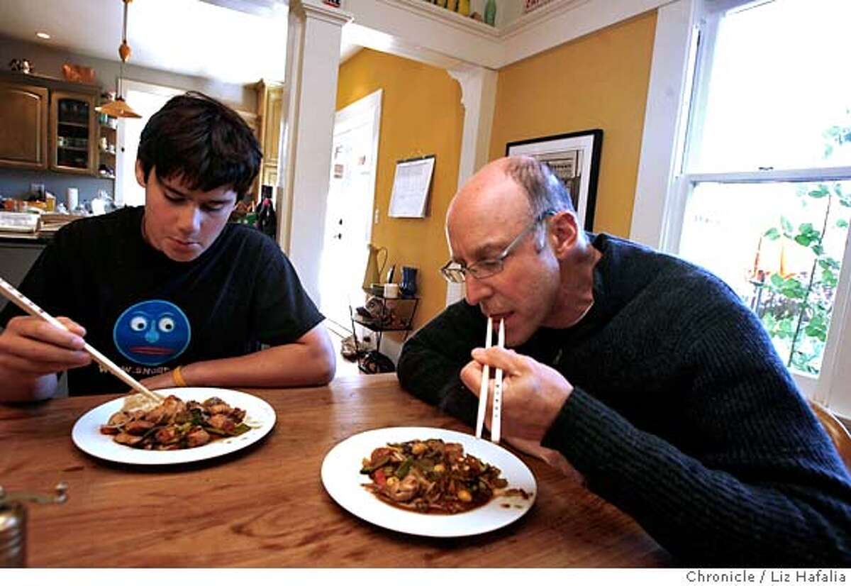 POLLAN_096_LH.JPG Michael Pollan and his son Isaac Pollan, 15 years old, sit down to eat the stir fry they made for lunch. Michael Pollan has become the leader of the Bay Area movement for better food, the farm bill, local food, farmers' markets, etc., and is out with a new book. Liz Hafalia/The Chronicle/BERKELEY/1/1/08 **Michael Pollan, Isaac Pollan cq �2007, San Francisco Chronicle/ Liz Hafalia MANDATORY CREDIT FOR PHOTOG AND SAN FRANCISCO CHRONICLE. NO SALES- MAGS OUT.