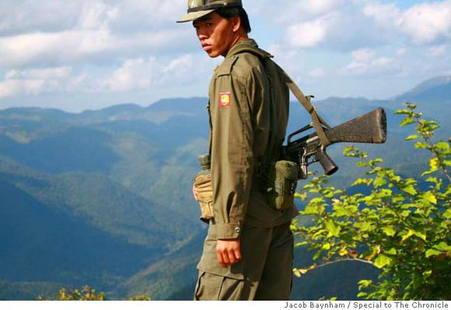 burmaXX_opium_PH02.JPG  A Shan State Army soldier guards the rebel headquarters near the border with Thailand.  Jacob Baynham / MANDATORY CREDIT FOR PHOTOG AND SAN FRANCISCO CHRONICLE/NO SALES-MAGS OUT Photo: Jacob Baynham