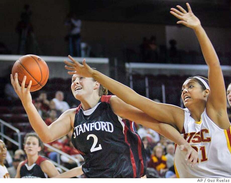 Standford's Jayne Appel (2) and Southern California's Aarika Hughes (21) fight for a rebound during the first half of their college basketball game, Sunday, Jan. 6, 2008, in Los Angeles. Cal won 57-52. (AP Photo/Gus Ruelas) Photo: Gus Ruelas