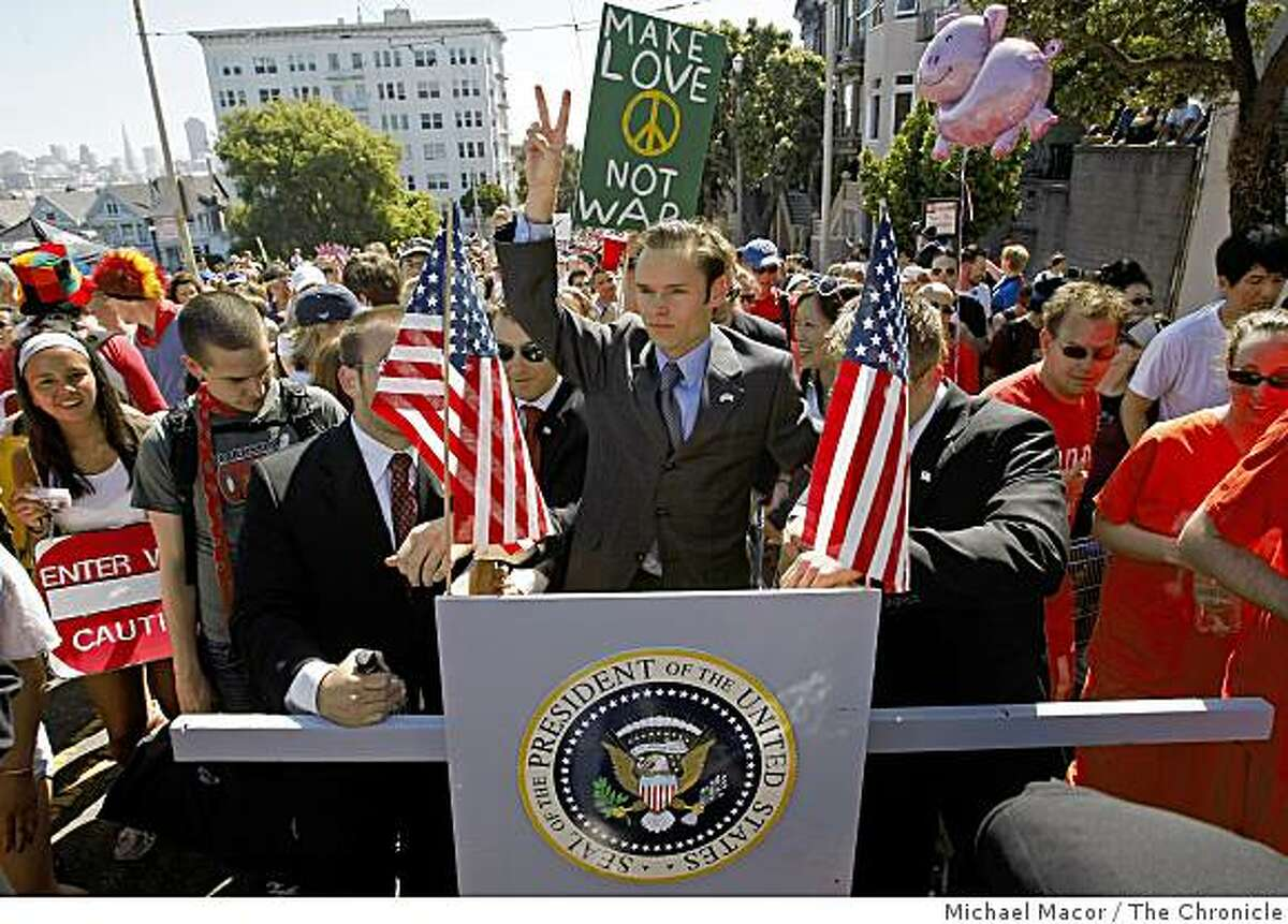 Dave Clayman, as the President of the United States, is joined by friends who are providing security as they make their way up Hayes Street Hill, during the 97th Bay to Breakers 12k foot race through the streets of San Francisco, Calif. on May 18, 2008.Photo by Michael Macor/ San Francisco Chronicle