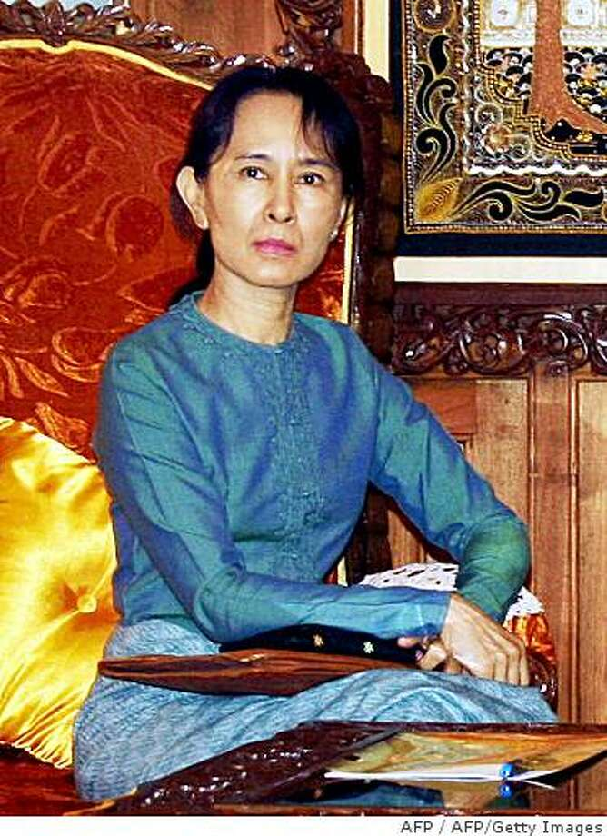 """(FILES) This file handout picture taken on January 30, 2008 shows Myanmar's pro-democracy leader Aung San Suu Kyi as she meets with the ruling junta's appointed labour minister, Aung Kyi, in Yangon. Southeast Asian foreign ministers expressed """"deep disappointment"""" late on July 20, 2008 over Myanmar opposition leader Aung San Suu Kyi's houes arrest and called for all political prisoners in the country to be freed. The Association of Southeast Asian Nations (ASEAN), which has been criticised in the past for its failure to act firmly against its renegade member, issued the strongly worded statement at the start of annual talks. TOPSHOTS   RESTRICTED TO EDITORIAL USE    AFP PHOTO / FILES / HO / MYANMAR NEWS AGENCY (Photo credit should read AFP/AFP/Getty Images) Photo: AFP, AFP/Getty Images"""