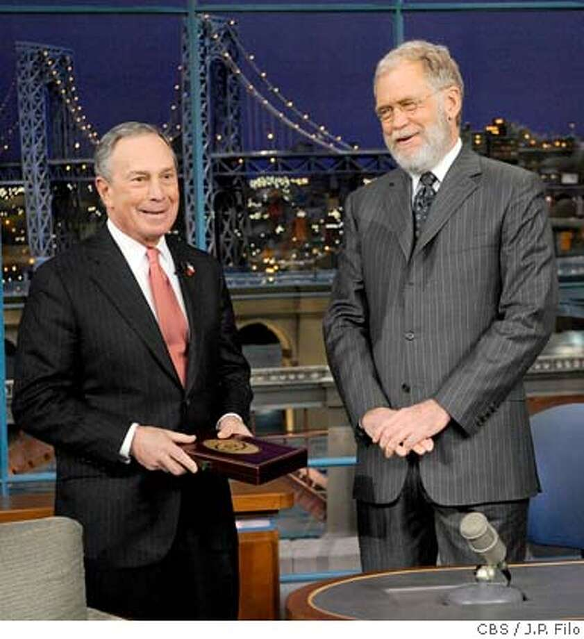 "In this photo released by CBS, New York City Mayor Michael Bloomberg presents host David Letterman with the Key to the City on the set of ""The Late Show with David Letterman,"" Thursday, Jan. 3, 2008 in New York. The honor wasn't meant for Letterman himself, but was actually awarded to Letterman's new beard. (AP Photo/CBS, J.P. Filo) **MANDATORY CREDIT; NO SALES; NO ARCHIVE; NORTH AMERICAN USE ONLY** Photo: J.P. Filo"