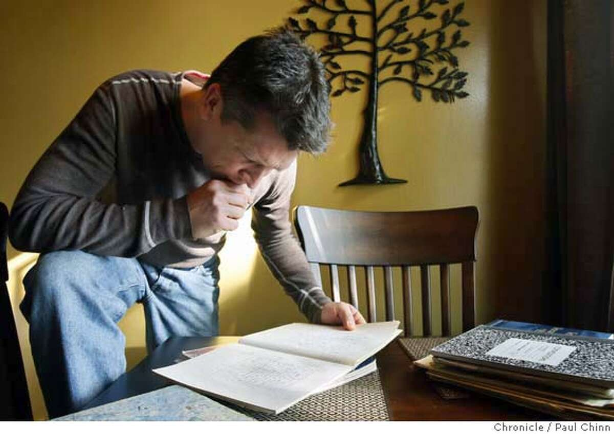 Gulf War veteran Sean McLean Brown browses through journals he wrote while serving in Iraq in the 90's at his home in Palo Alto, Calif. on Saturday, Dec. 22, 2007. Many of Brown's writings, as a member of a veteran's writing group, were published in the book
