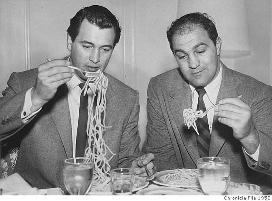 1958 - Rock Hudson (left) and boxer Rocky Marciano eat spaghetti at the Fairmont Hotel in January 1958 Photo: Bill Young