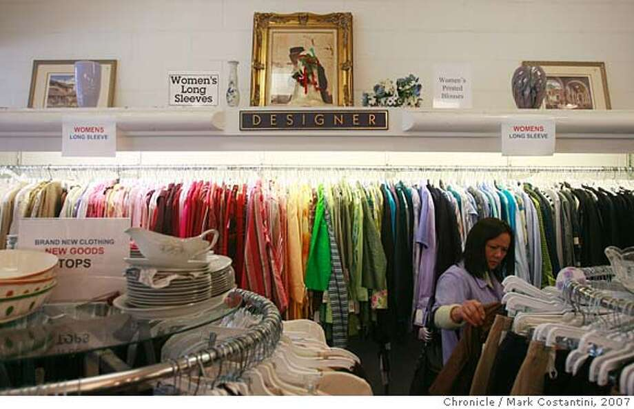 Streetdate photos of Santa Cruz Avenue, Menlo Park from cross streets beginning at Chestnut Street and ending at El Camino Real.  A shopper looks at designer clothes at the Goodwill Boutique, 711 Santa Cruz Avenue. Mark Costantini / The Chronicle Photo taken on 12/27/07, in Menlo Park, CA, USA Photo: Mark Costantini