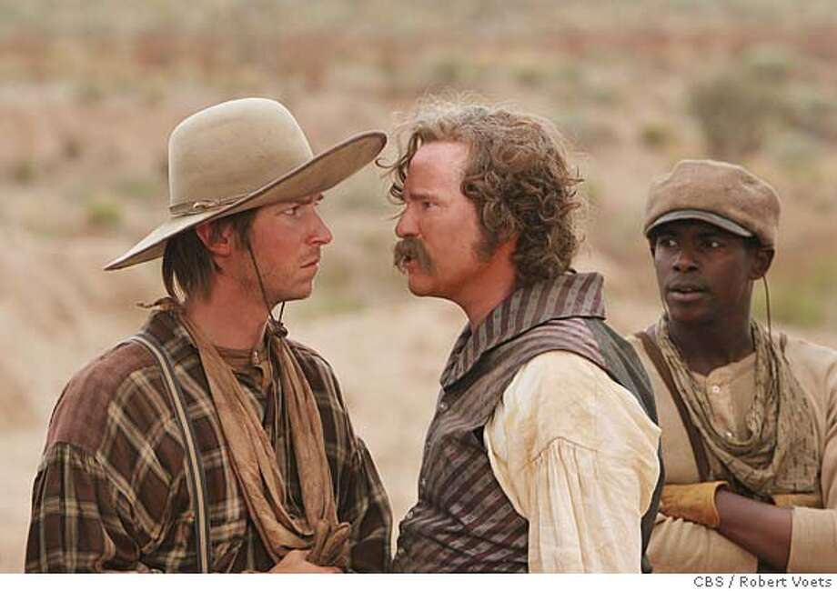 Captain Inish Scull, (Val Kilmer, center, seen here with Troy Baker as Pea Eye Parker (left) and Keith Robinson as Joshua Deets (right) is a Yankee aristocrat and hero of the recently concluded Mexican War, leads a squad of Texas Rangers in the bitter struggle to protect an advancing western frontier against the defiant Comanches who are determined to defend their territory and their way of life, in COMANCHE MOON, a six-hour mini-series to be broadcast Sunday Jan. 13, Tuesday Jan. 15 and Wednesday Jan. 16 (9:00-11:00 PM, ET/PT each night) on the CBS Television Network. Photo: Robert Voets/CBS �2006 CBS Broadcasting Inc. All Rights Reserved. Photo: ROBERT VOETS
