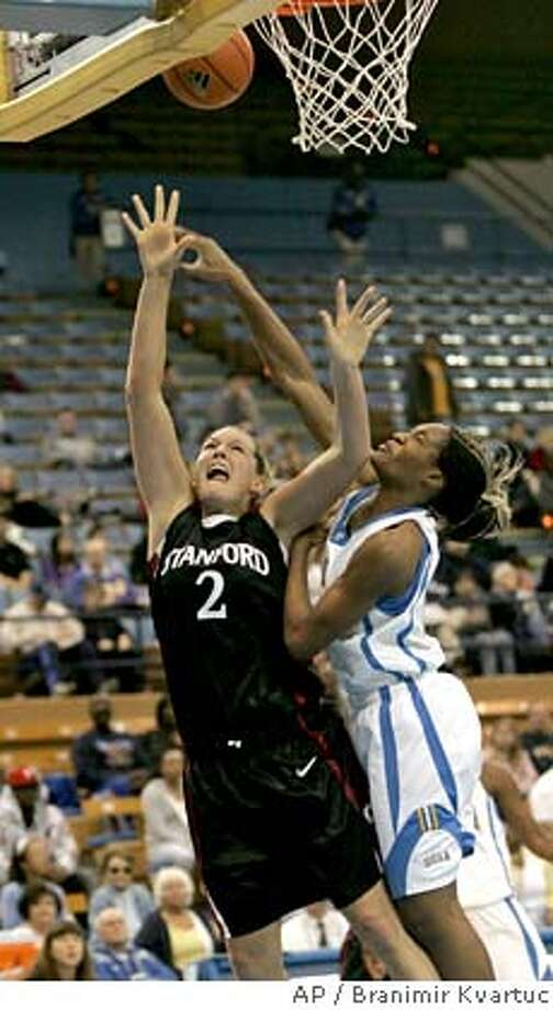 UCLA's Chinyere Ibekwe, right, fouls Stanford's Jayne Appel as she goes up for a shot during the first half of a women's college basketball game in Los Angeles on Friday, Jan. 4, 2007. (AP Photo/Branimir Kvartuc) EFE OUT Photo: Branimir Kvartuc