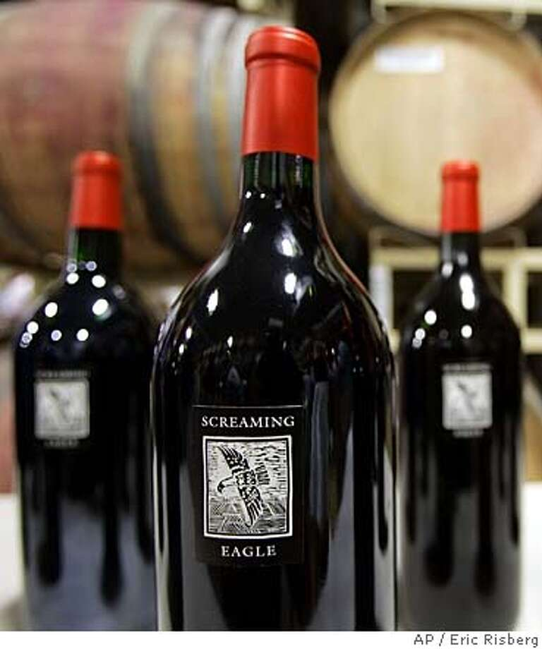 Three magnums, part of a vertical lot of 12 bottles of Screaming Eagle Cabernet Sauvignon wine are shown on display during the Napa Valley wine auction in St. Helena, Calif., Friday, June 2, 2006. The three-day event, featuring a barrel auction, an online auction and the centerpiece live auction Saturday night, raised $8.4 million in all, organizers said. (AP Photo/Eric Risberg)  Ran on: 06-08-2006  Joy Craft (far right) paid $1.05 million at Auction Napa Valley for a lot arranged by Shari and Garen Staglin (center). Ryan Seacrest (left) emceed. Another lot included a Screaming Eagle vertical.  Ran on: 06-08-2006 Ran on: 08-03-2006  A dozen Screaming Eagle magnums (1.5-liter bottles) sold for $460,000 at Auction Napa Valley in June.  Ran on: 08-03-2006  A dozen Screaming Eagle magnums (1.5-liter bottles) sold for $460,000 at Auction Napa Valley in June.  Ran on: 06-01-2007 Photo: ERIC RISBERG