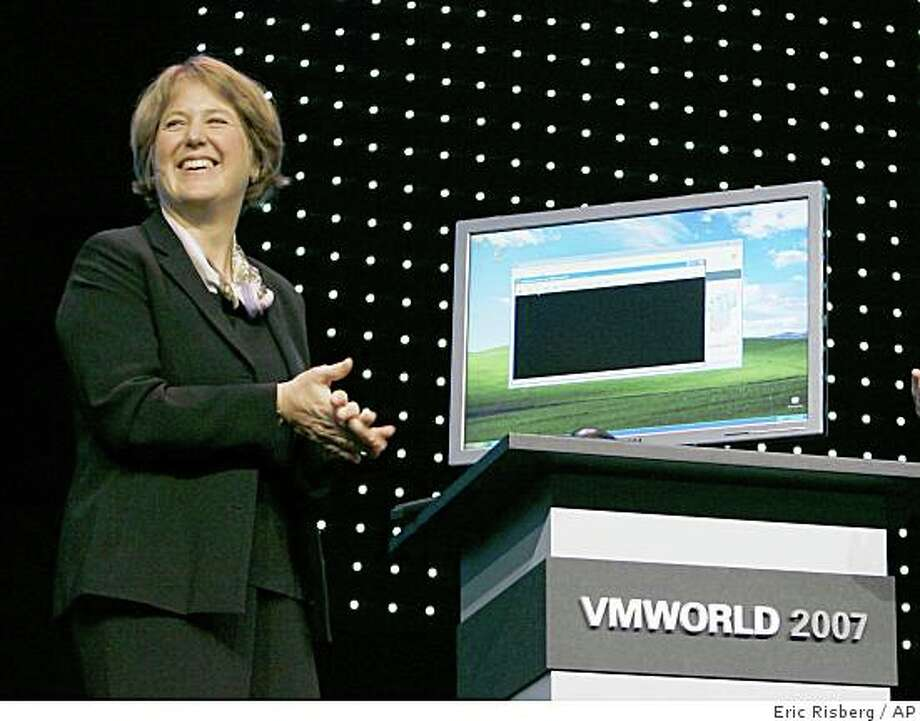 Diane Greene, CEO of VMware Inc. smiles after showing a virtualization demo with the new ESX3i during her keynote address at the VMworld 2007 conference in San Francisco, Tuesday, Sept. 11, 2007. (AP Photo/Eric Risberg) Ran on: 09-12-2007 VMware CEO Diane Greene explains how virtualization works during the keynote address at the VMworld conference. Ran on: 12-31-2007 Diane Greene demonstrates her company's product at the VMworld conference. Ran on: 12-31-2007 Diane Greene Ran on: 12-31-2007 Diane Greene Photo: Eric Risberg, AP