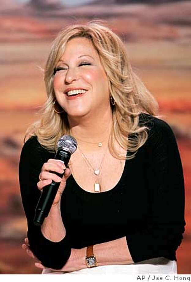** FILE ** Bette Midler smiles as she speaks during a news conference at the Caesars Palace in Las Vegas, in a Thursday, May 3, 2007 photo. Entertainer Bette Midler is expected to be fined by the state of Hawaii for cutting down more than 230 trees around one of her properties on Kauai. (AP Photo/Jae C. Hong, file) A MAY 3, 2007 FILE PHOTO Photo: Jae C. Hong