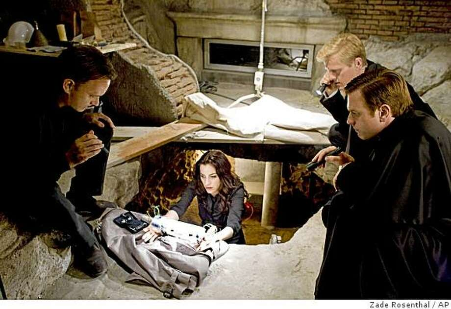 "In this film publicity image released by Columbia Pictures/Sony Entertainment, from left, Tom Hanks, Ayelet Zurer, Thure Lindhart and Ewan McGregor are shown in a scene from, ""Angels & Demons."" Photo: Zade Rosenthal, AP"
