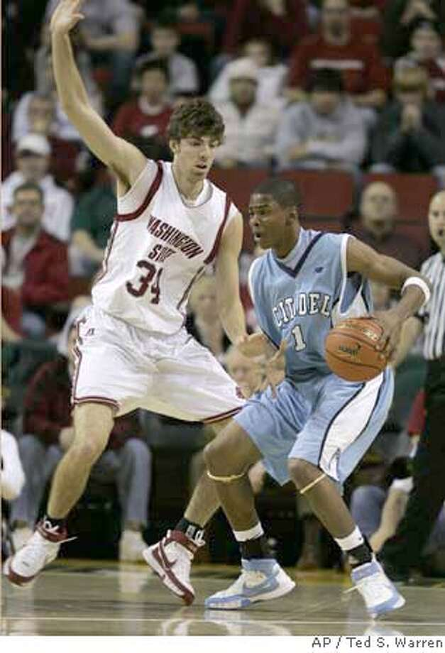 The Citadel's Tyrell McDowell, right, tries to drive around Washington State forward Robbie Cowgill, left, during the first half of a basketball game Thursday, Dec. 20, 2007, in Seattle. (AP Photo/Ted S. Warren) EFE OUT Photo: Ted S. Warren