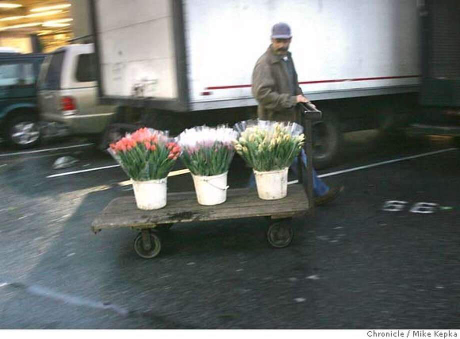 flowermarket201_mk.jpg Ramon Jimenez wheels a batch of tulips to the parking lot for a customer of the SF Flower Market.  The San Francisco flower market at 6th and Brannan is a tradition that comes alive hours before the sun meets the sky.  Mike Kepka / The Chronicle  contest yip MANDATORY CREDIT FOR PHOTOG AND SF CHRONICLE/NO SALES-MAGS OUT Photo: Mike Kepka