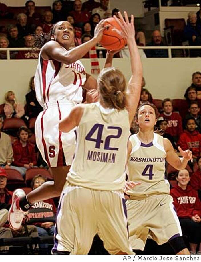 Stanford's Candice Wiggins, top left, shoots over Washington's Sara Mosiman (42) and Emily Florence (4) during the first half of a basketball game in Stanford, Calif., Sunday, Dec. 30, 2007. (AP Photo/Marcio Jose Sanchez) Photo: Marcio Jose Sanchez