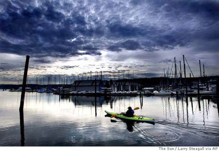 Penny Garner of Poulsbo, Wash., takes her kayak out for the first time this year on a warm day Wednesday, Jan. 26, 2005, at the Poulsbo Marina. (AP Photo/The Sun, Larry Steagall) Ran on: 01-30-2005  here. STAND ALONE; A JAN. 26, 2005, PHOTO Photo: LARRY STEAGALL