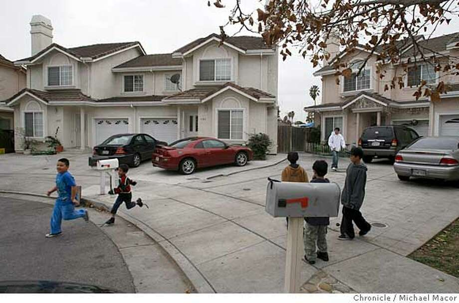 Neighborhood kids play near the home of two victims of the tiger attack, the Dhaliwal brothers. Chronicle photo by Michael Macor