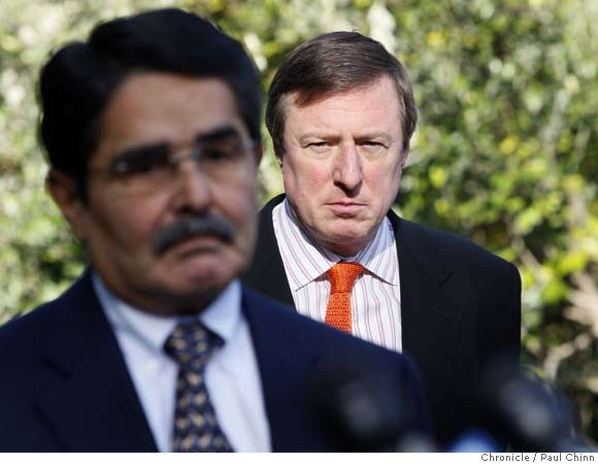 Public relations expert Sam Singer (right) listens to zoo director Manuel Mollinedo (left) reveal details about security upgrades planned for the tiger exhibits at a news conference in San Francisco, Calif. on Wednesday, Jan. 2, 2008. Management brought in Singer to handle the zoo's public relations crisis after Siberian tiger Tatiana escaped from her enclosure, killed one visitor and injured two others on Christmas Day. PAUL CHINN/The Chronicle **Sam Singer, Manuel Mollinedo MANDATORY CREDIT FOR PHOTOGRAPHER AND S.F. CHRONICLE/NO SALES - MAGS OUT