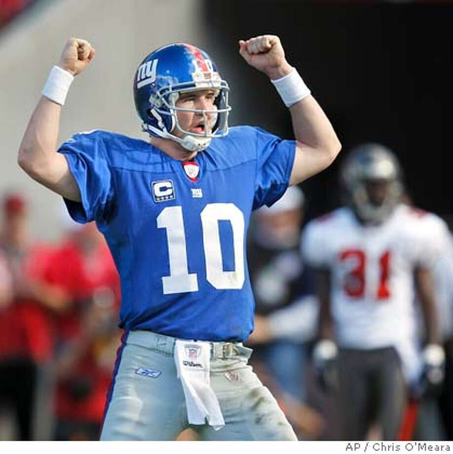 New York Giants quarterback Eli Manning celebrates after throwing a fourth-quarter touchdown pass to teammate Amani Toomer during an NFL wild-card football playoff game against the Tampa Bay Buccaneers Sunday, Jan 6, 2008, in Tampa, Fla. (AP Photo/Chris O'Meara) Photo: Chris O'Meara