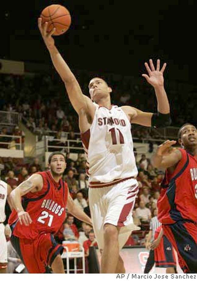 Stanford's Brook Lopez (11) grabs a rebound in front of Fresno State's Hector Hernandez, left, of Mexico, and Alex Blair, right, in the first half of a college basketball game in Stanford, Calif., Saturday, Dec. 29, 2007.(AP Photo/Marcio Jose Sanchez) EFE OUT Photo: Marcio Jose Sanchez