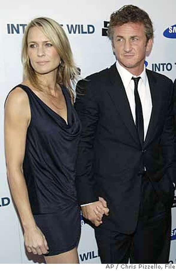 ** FILE **Sean Penn and his wife, Robin Wright Penn, seen here in Los Angeles in a file photo taken Sept. 18, 2007, are splitting up. Their publicist tells People magazine's Web site that the couple are divorcing after 11 years of marriage. The couple have two teenage sons. (AP Photo/Chris Pizzello) Photo: Chris Pizzello