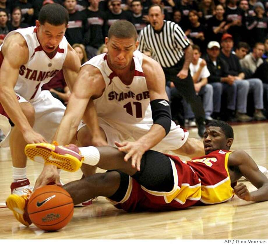 Stanford's Mitch Johnson, left, and Brook Lopez (11) go after a loose ball at the legs of Southern California's Angelo Johnson in the first half of an NCAA basketball game, Saturday, Jan. 5, 2008, at Stanford, Calif. (AP Photo/Dino Vournas) EFE OUT Photo: Dino Vournas