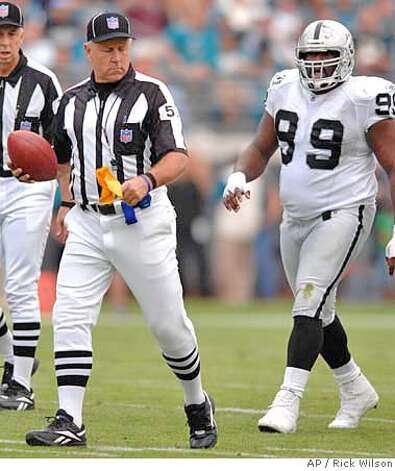 Oakland Raiders defensive tackle Warren Sapp chases down and yells at official Garth DeFelice, who steps off yardage on one of Sapp's three successive unsportsmanlike conduct penalties late in the first half of the Jacksonville Jaguars' 49-11 victory over the Raiders on Sunday, Dec. 23, 2007, in Jacksonville, Fla. (AP Photo/The Florida Times-Union, Rick Wilson) ** TV OUT MAGS OUT ** TV OUT MAGS OUT EFE OUT EFE OUT Photo: Rick Wilson