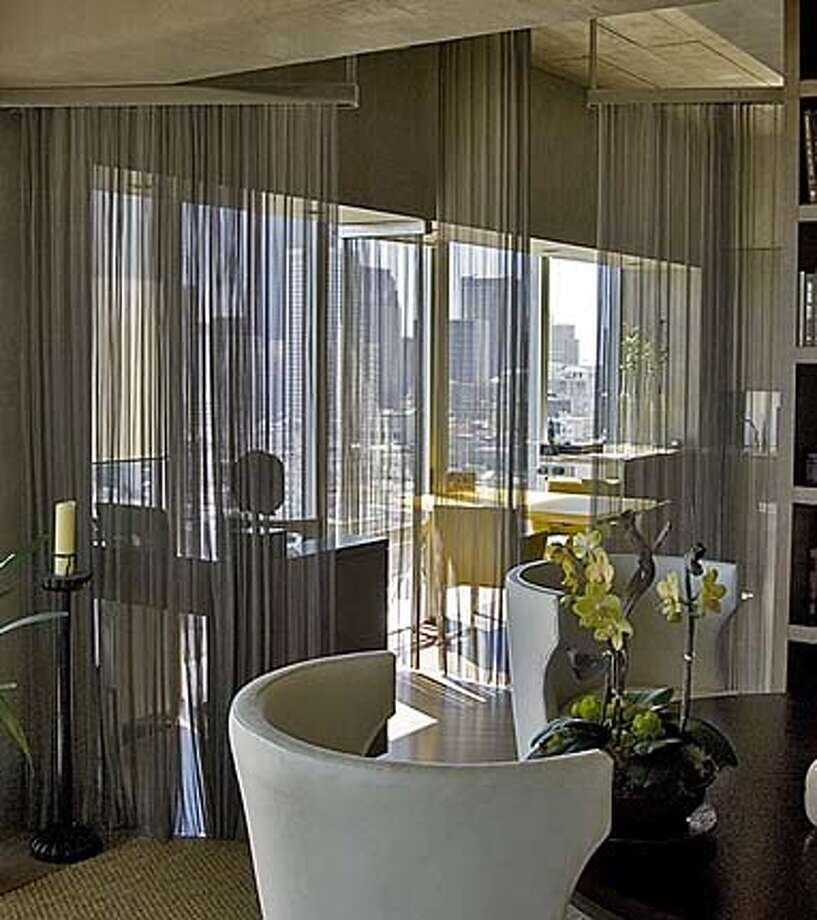 Cascade Coil wire mesh as a room divider Photo: Ho