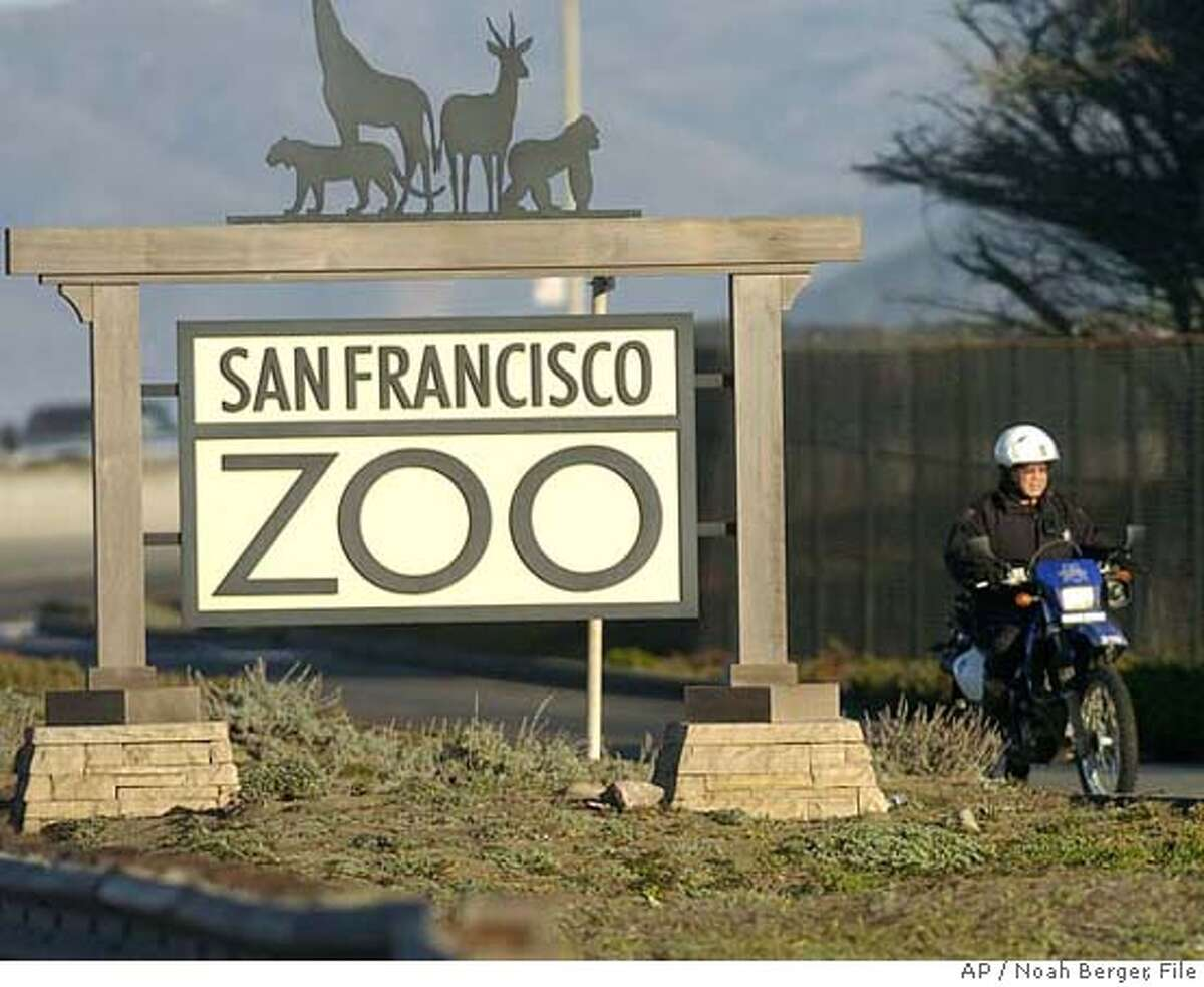 A motorcycle police officer prepares to enter the San Francisco Zoo on Wednesday, Dec. 26, 2007, to search for additional victims of Tuesdays tiger attacks. Tatiana, a 350-pound Siberian tiger, escaped from its enclosure and attacked three people Tuesday, killing one. (AP Photo/Noah Berger)