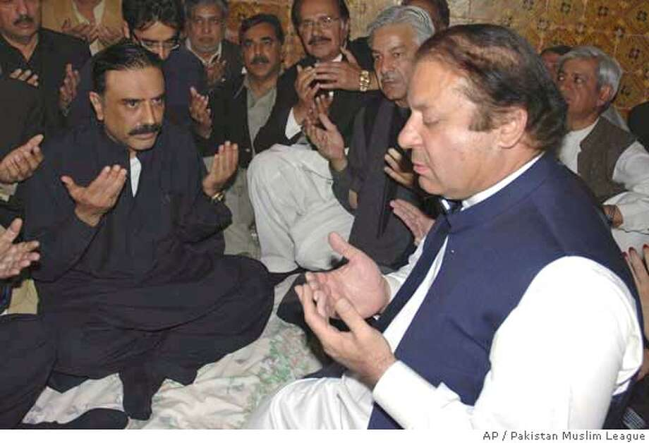 In this photo released by Pakistan Muslim League, Pakistan's former prime Minister Nawaz Sharif, right, and rival of Pakistan's former prime Minister Benazir Bhutto meets Bhutto's husband Asif Ali Zardari in Naudero near Larkana, Pakistan on Saturday, Dec. 29, 2007. Pakistan's government asserted Friday that al-Qaida was behind the assassination of Benazir Bhutto, and offered the transcript of a conversation as proof. (AP Photo/Pakistan Muslim League/ho) Photo: Pakistan Muslim League