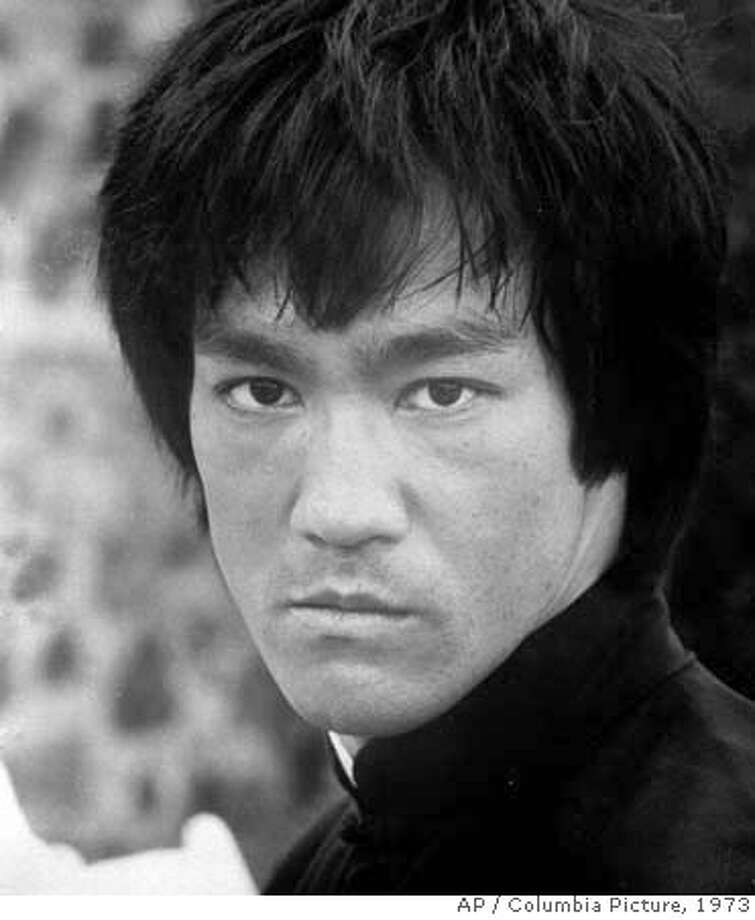 "** FILE **In this 1973 file photo released by Columbia Picture, shown is the late martial art movie star Bruce Lee. Hollywood studio Warner Bros. said Thursday, Aug. 16, 2007, it plans to remake the 1973 Bruce Lee movie ""Enter the Dragon."" (AP Photo/Columbia Picture, HO, File)  Ran on: 08-17-2007  Bruce Lee, star of &quo;Enter the Dragon,&quo; died at 32 in 1973. THIS 1973 FILE PHOTO RELEASED BY COLUMBIA PICTURE Photo: Ap"